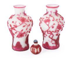 A pair of Chinese pink overlay white Peking glass 'Bird and Prunus Tree' vases