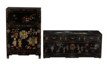 A Chinese black lacquered low cabinet