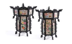 A large pair of Chinese wood and painted silk hanging lanterns