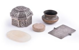 A group of Central Asian and Iranian metalworks including a Qajar agate plaque