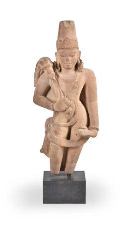 A fine large buff sandstone figure of a Chauri Bearer 9-11th century