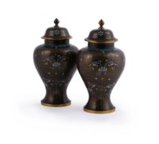 A pair of Chinese cloisonne baluster vases and covers