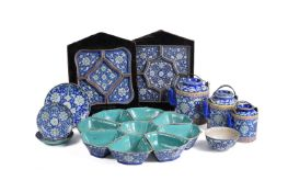 Three Chinese blue and turquoise enamelled 'Shou' teapots and covers