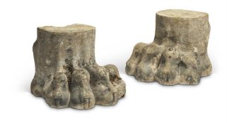 A pair of Regency carved stone lion paw supports