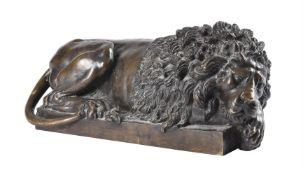 After Antonio Canova (Venetian 1757-1822), A bronze model of a recumbent lion