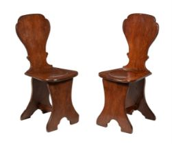 A pair of George II oak sgabello hall chairs