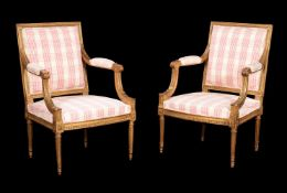 A pair of French giltwood armchairs