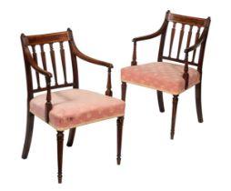 A pair of George III mahogany armchairs