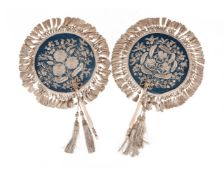 Y A pair of ivory hand fans