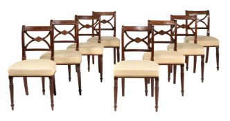 A set of eight Regency mahogany and brass inlaid dining chairs
