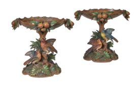 A pair of carved wood and polychrome decorated centrepieces or comports