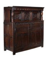 A Charles II carved oak court cupboard