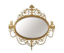 A giltwood and composition oval wall mirror