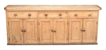 A Victorian pine and sycamore dresser base