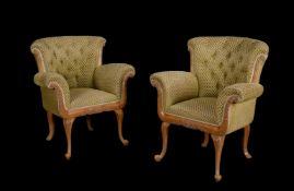 A pair of beech salon chairs