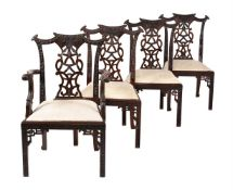 A set of eight carved hardwood dining chairs in George III style