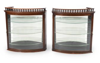 A pair of Victorian mahogany and glazed hanging display cabinets
