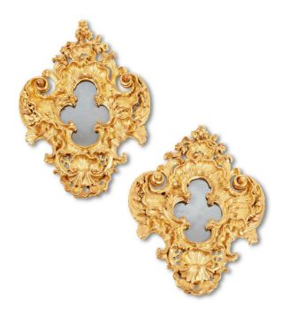 A PAIR OF CONTINENTAL CARVED GILTWOOD WALL MIRRORS