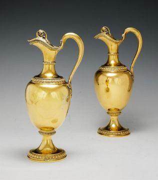 A PAIR OF VICTORIAN SILVER GILT OVOID CLARET JUGS BY GARRARD & CO.