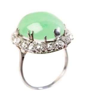 A MID 20TH CENTURY JADEITE AND DIAMOND CLUSTER RING