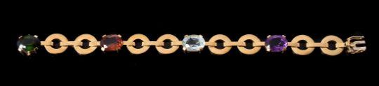 A GOLD COLOURED MULTI GEM BRACELET