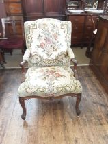 Georgian walnut Gainsborough chair with acanthus carved scroll arms upon carved cabriole legs with