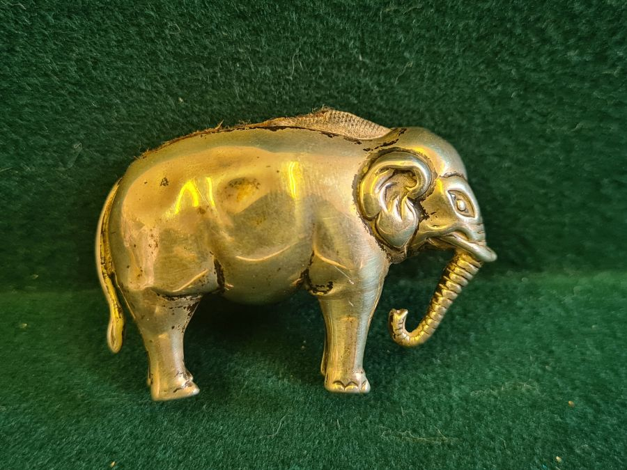 An early 20th century silver elephant pin cushion, marks indistinct, 4.50cm long. - Image 5 of 5