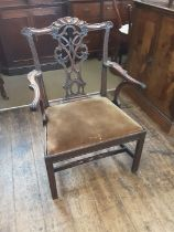 Georgian Gothic Chippendale broad arm carver chair with carved top rail, fine pierced central