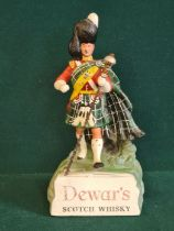 A counter top composition Dewar's White Label Scotch Whisky advertising figure.