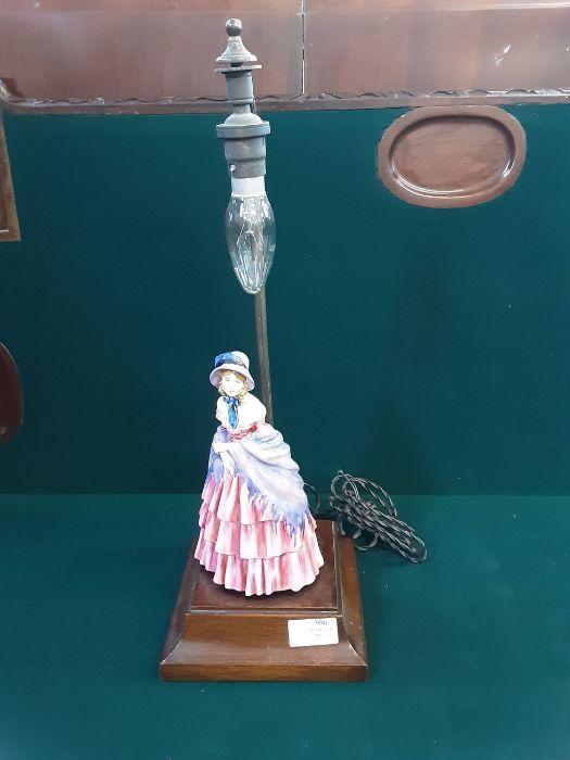 1950's crinoline lady table lamp on mahogany base with bakelite switch.