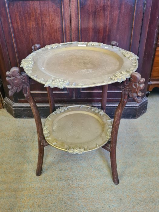Indian carved folding 2 tier occasional table with 2 heavy brass trays.
