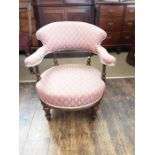 Edwardian walnut tub chair with turned and reeded supports and front legs.
