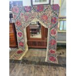 A large Victorian embroidered doorway drape and a similar 2.4m x 1.6m embroidered drape.