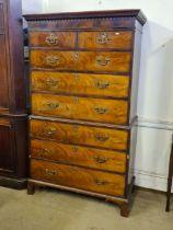 George III mahogany flame veneer 8 drawer tallboy with Greek key and dental pediment, later