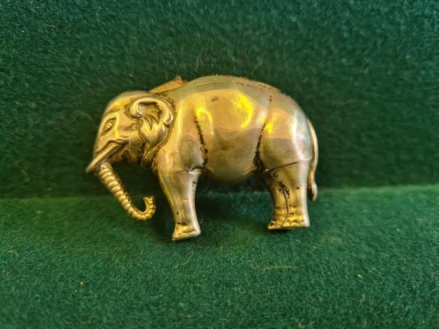 An early 20th century silver elephant pin cushion, marks indistinct, 4.50cm long. - Image 2 of 5