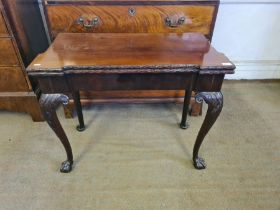 Georgian mahogany card table with outset corners, acanthus carved edging upon carved ball and claw