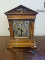 An oak cased Winterhalder & Hofmeier bracket clock with quarter chiming movement, brass dial with