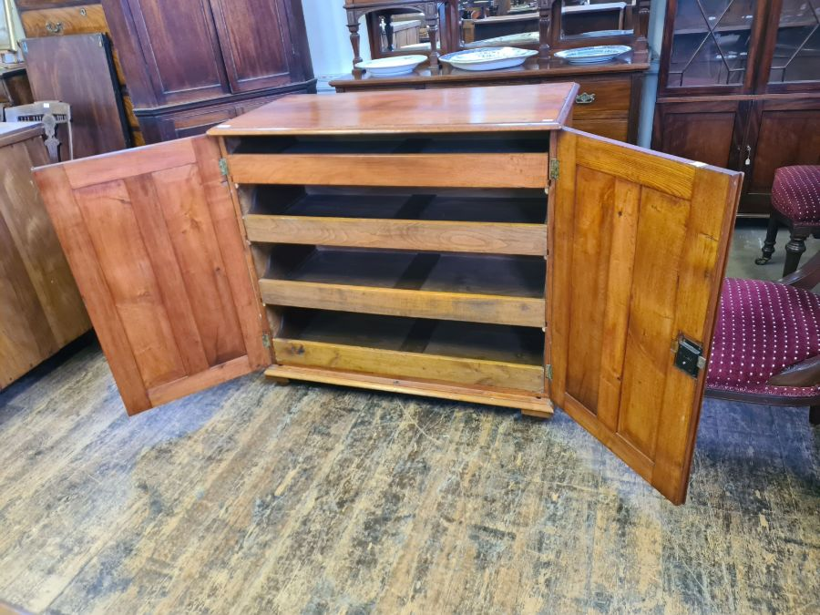 An oak 2 door linen press with 4 slider drawers, 110cm wide x 103cm tall.
