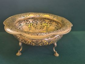 A large Eugen Marcus German silver bowl with shaped folded rim, foliate pierced decoration on shaped