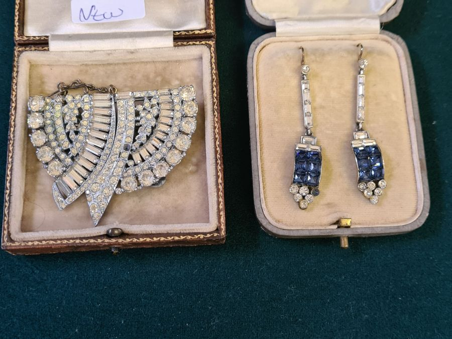 An art deco diamante double clip brooch and a pair of art deco drop earrings.