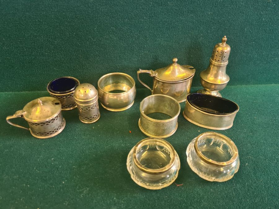 Various silver condiments, napkin rings, etc., makers to include Walker & Hall 140g silver content.