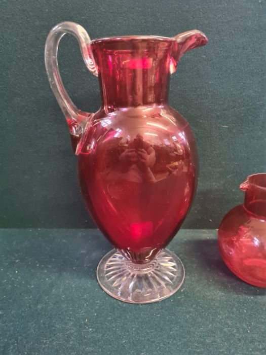 """Large Victorian cranberry glass jug with clear cut foot standing 11"""" tall and a similar smaller - Image 2 of 5"""