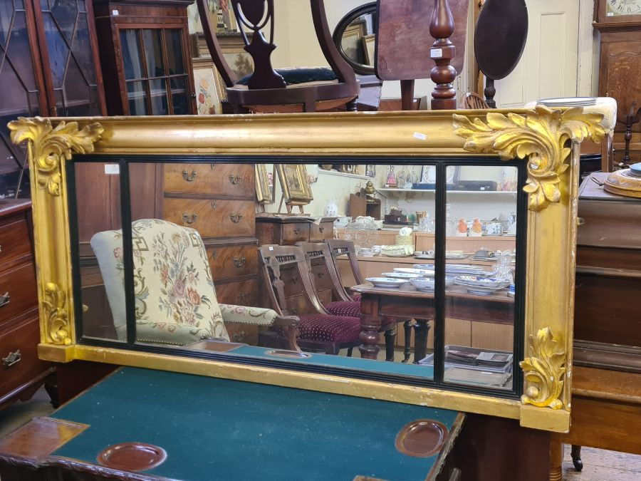 Regency gilt overmantle mirror with applied acanthus leaves and reeded glazing bars, 140cm x 62cm.