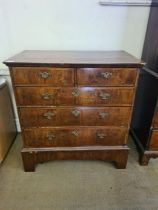 An early 18th Century walnut chest of 5 drawers, quarter veneer figured walnut top with geometric