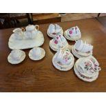 Gilt decorated porcelain tete a tete teaset and 2 gilt floral teasets.