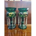 Pair of Victorian green gilt lustres standing approx. 22.5cm tall, slight chipping to top rims.