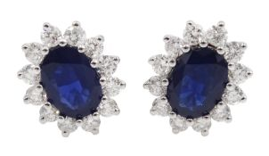 Pair of white gold sapphire and diamond cluster stud earrings, stamped 18K, total sapphire weight ap