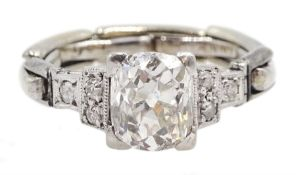 Art Deco platinum diamond ring, the central cushion cut diamond of approx 1.10 carat, with three dia