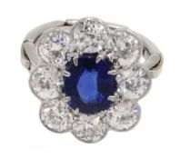 Early 20th century platinum sapphire and diamond cluster ring, the central oval sapphire with eight