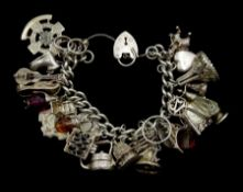 Heavy silver curb chain bracelet, with various charms including rabbit in a hut, money box teapot, g